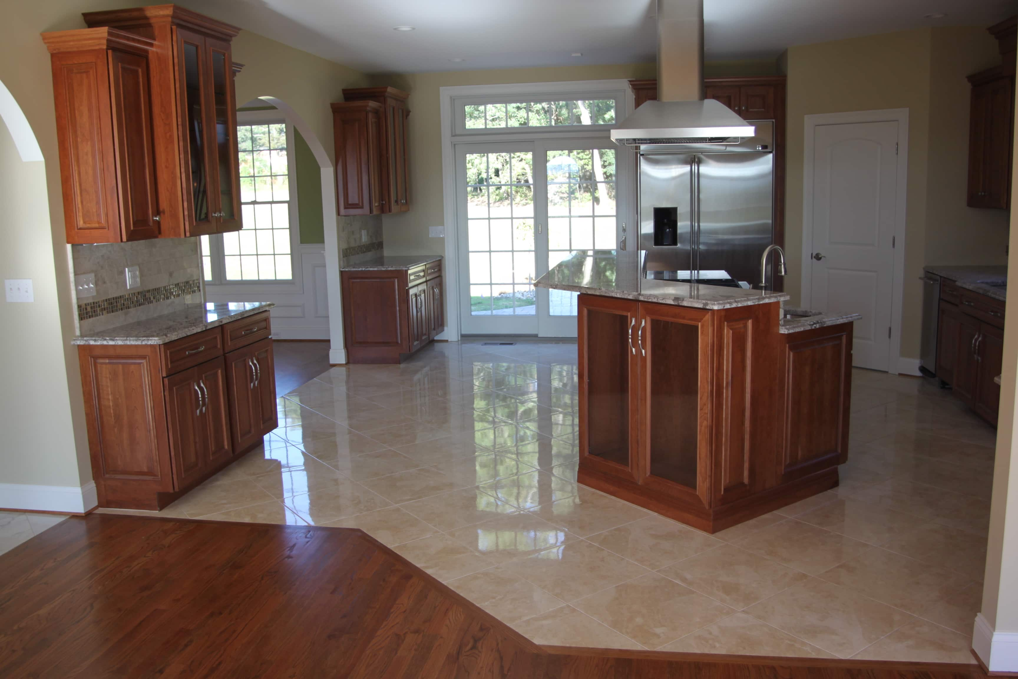 Should your flooring match your kitchen cabinets or for Floors to match cherry cabinets