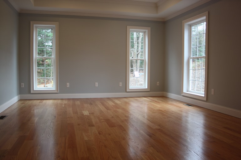 Sand and refinished hardwood bedroom floor