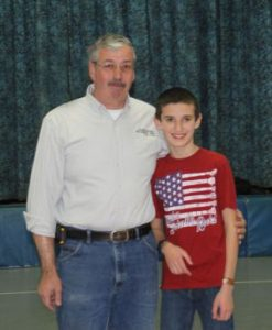 John and Tyler Andryzeck pose after the unveiling of the eagle mural at Barkhamsted Elementary School on Monday morning. John Andryzeck, an employee of Dalene Flooring, facilitated the donation of the mural and helped install it. Kathryn Boughton Republican-American